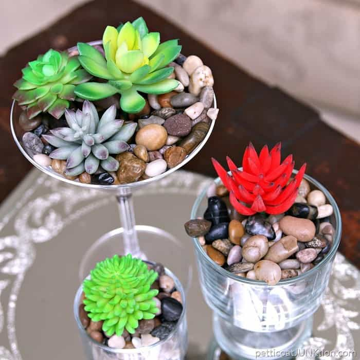 fancy faux succulents in thrift store glasses require no water
