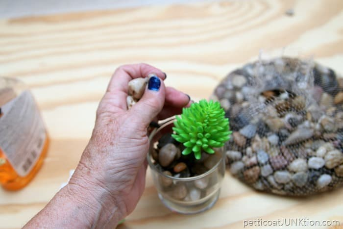 fill container with river rocks