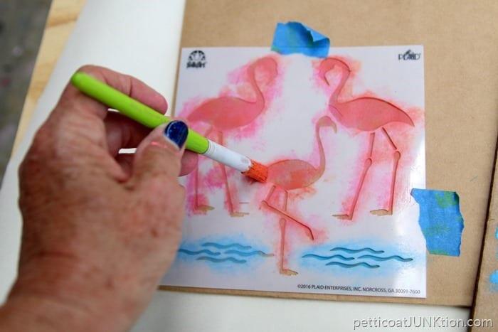 stenciling pink flamingos