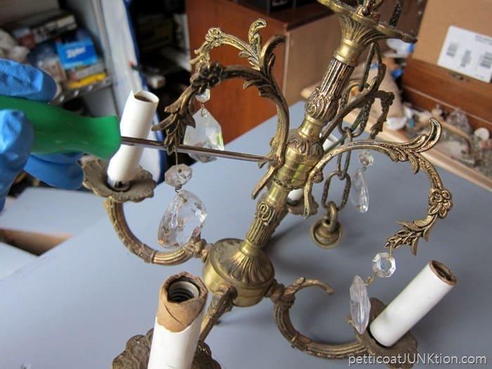 tighten screws and straighten chandelier pieces