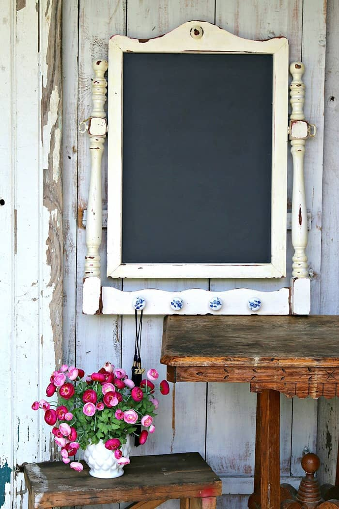 White Framed Chalkboard With A Few Hang Ups