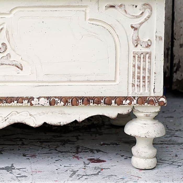 It's easy to make white painted furniture look old with tools straight out of your kitchen drawer.