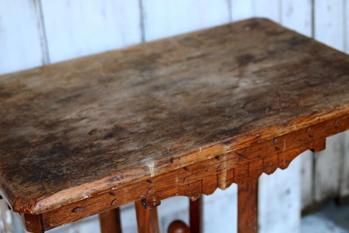 antique table in rough condition
