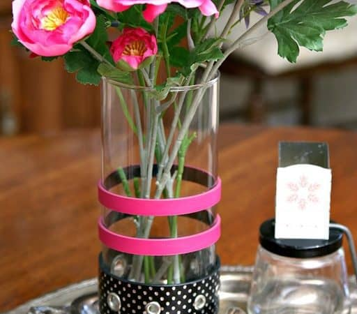 glass flower vase decorated with belts