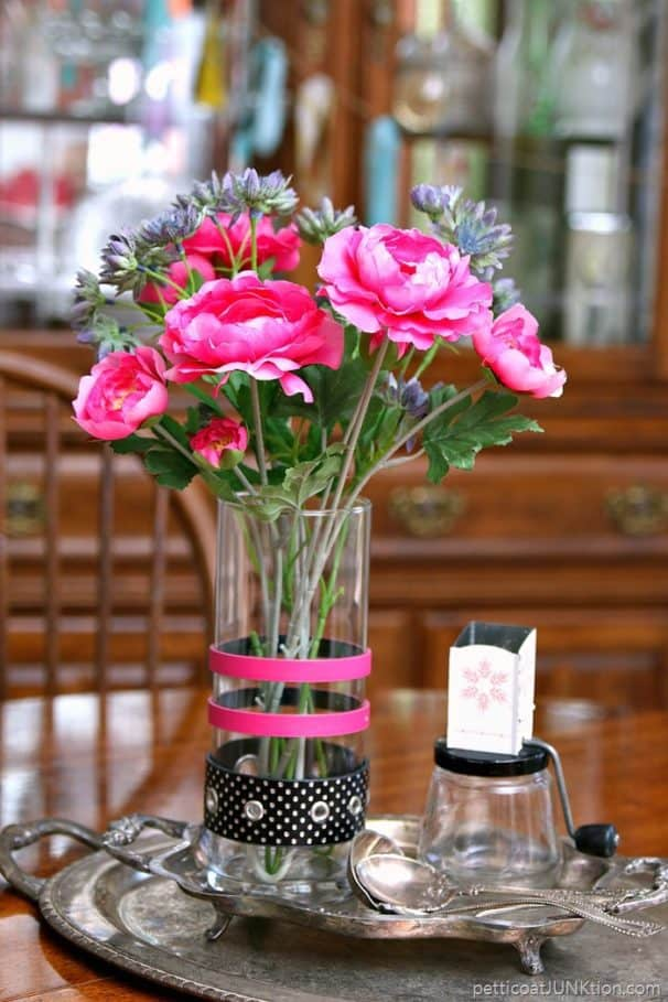 trash to treasure makeover using recycled belts to decorate a glass vase