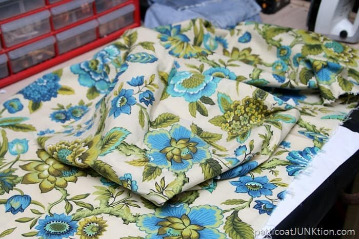 thrift store fabric with pretty design in blue, turquoise, and green