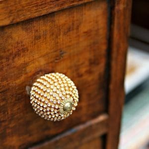 vintage wardrobe with blingy knobs and a chandelier