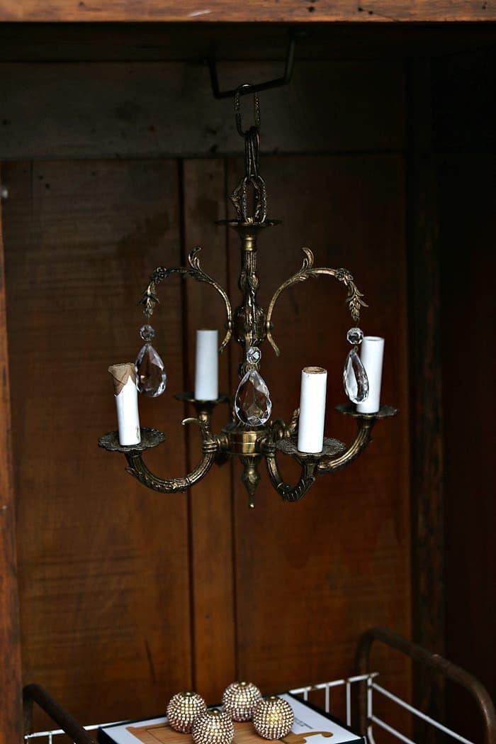 hang a vintage chandelier in wood wardrobe