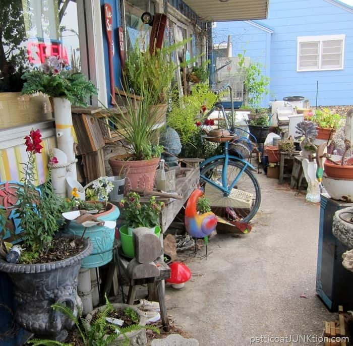 outdoor junk decor and flowers at The Blue Building Antiques