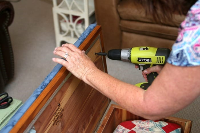remove the padded seat from a Land Cedar Chest