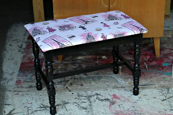 Pink Paris themed fabric looks great with black spray painted stool
