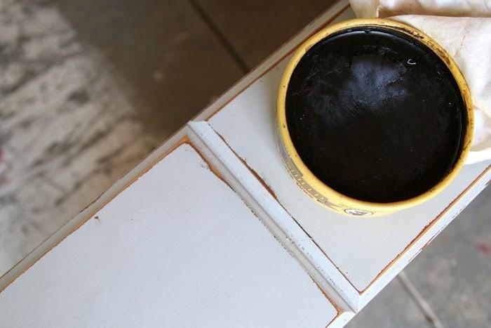 applying dark wax to make raw wood look aged