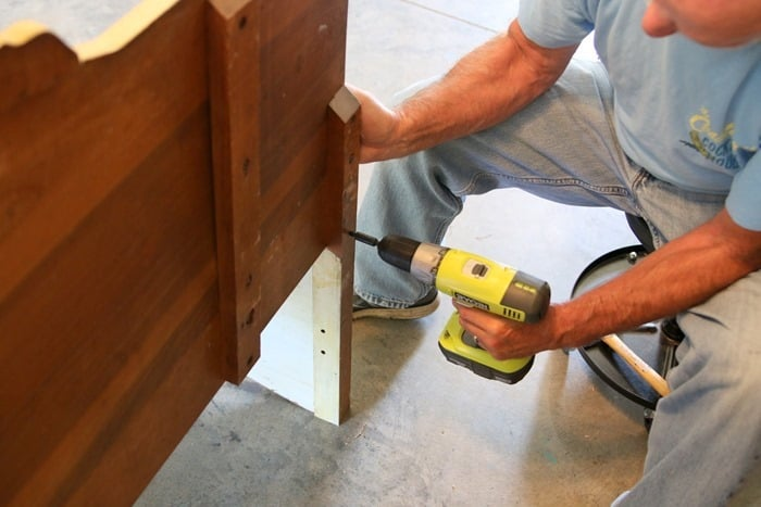 attaching the sides of the bench to the back