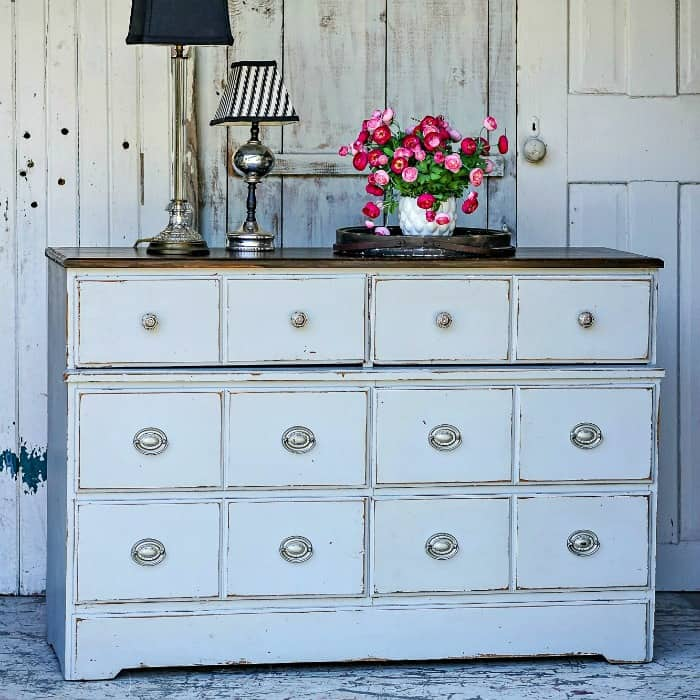 silvery blue dresser with silver knobs and stained top