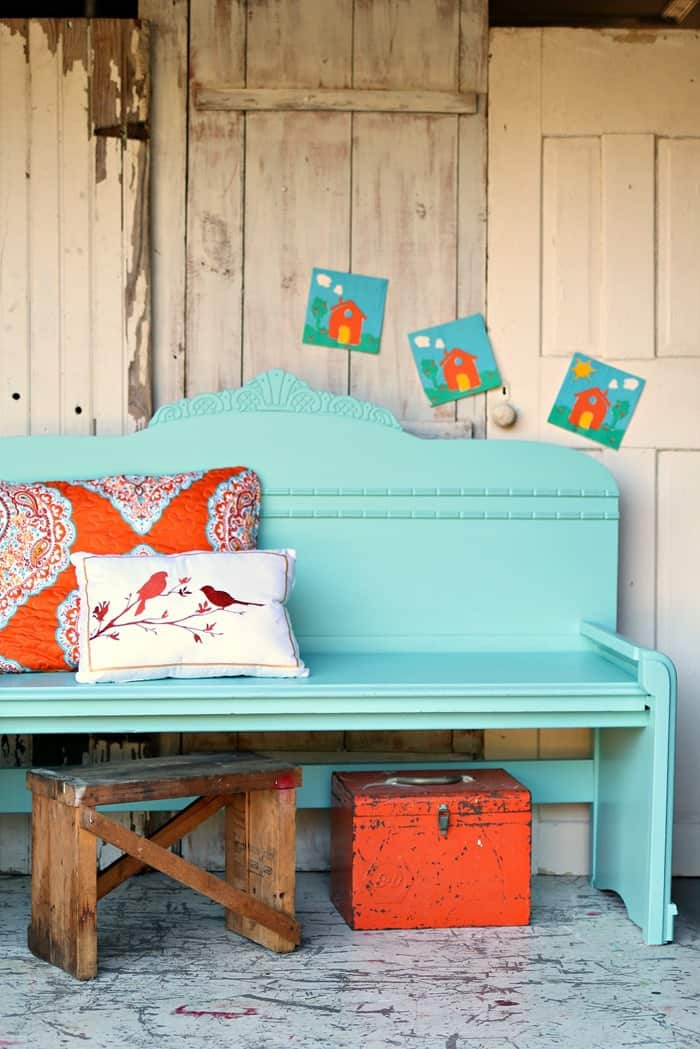 turquoise and orange color combination for the headboard bench made from a vintage bed