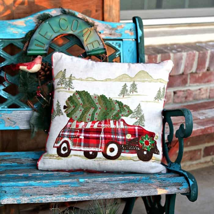 Christmas pillow from World Market spruces up shabby outdoor chair