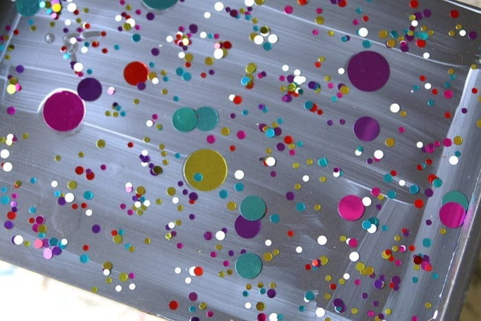 sprinkle confetti on mod podge for craft furniture project