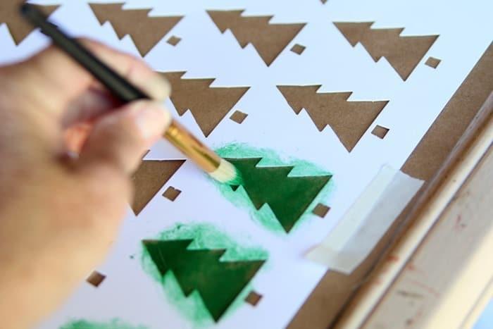 stenciling tree designs on brown kraft paper