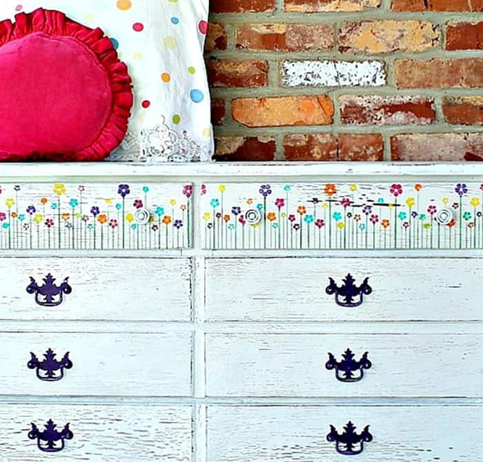 white dresser with pretty stenciled flowers