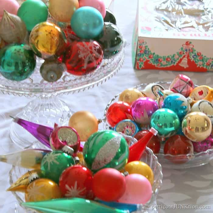 Chrismtas ornaments displayed on glass cake stands