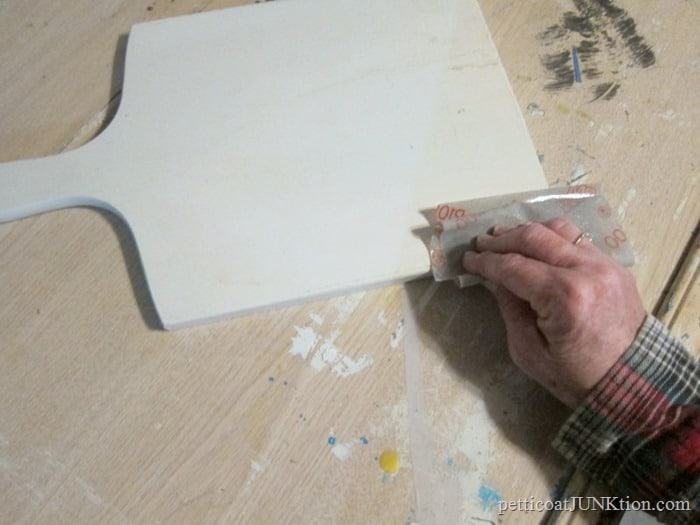 distress paint with flexible sandpaper