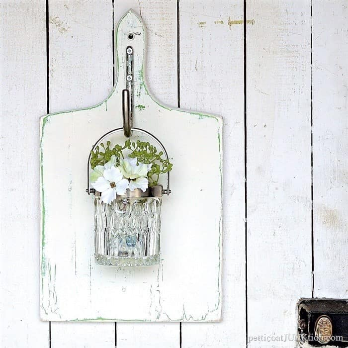 hanging glass wall vase made from thrift store finds