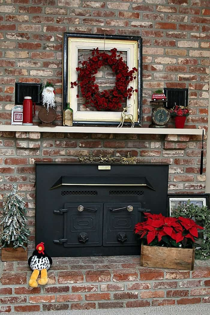 red and rust color scheme for decorating the Christmas mantel