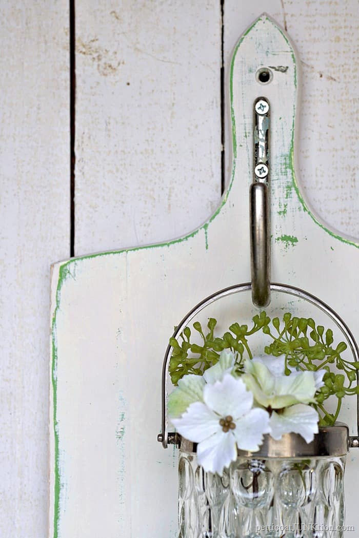 silver and cut glass hanging wall vase