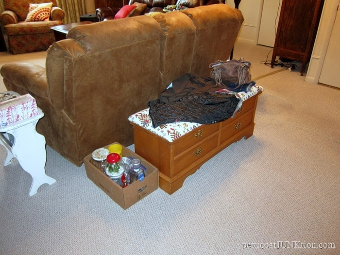 coats tossed on cedar chest