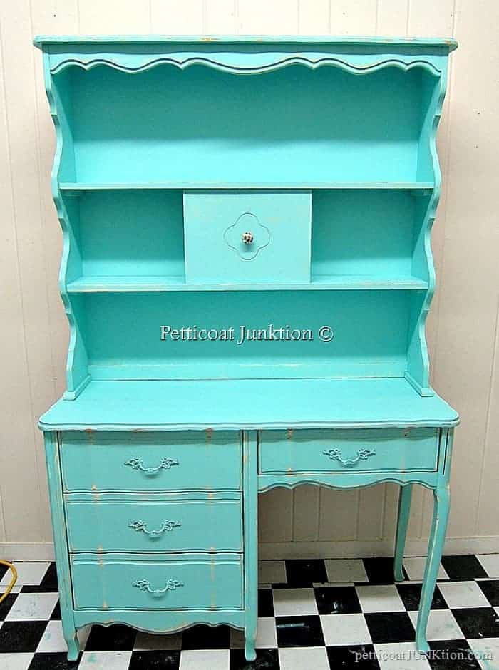 Beautiful French Provincial hutch and dresser painted turquoise is one of 15 diy turquoise furniture makeovers featured today