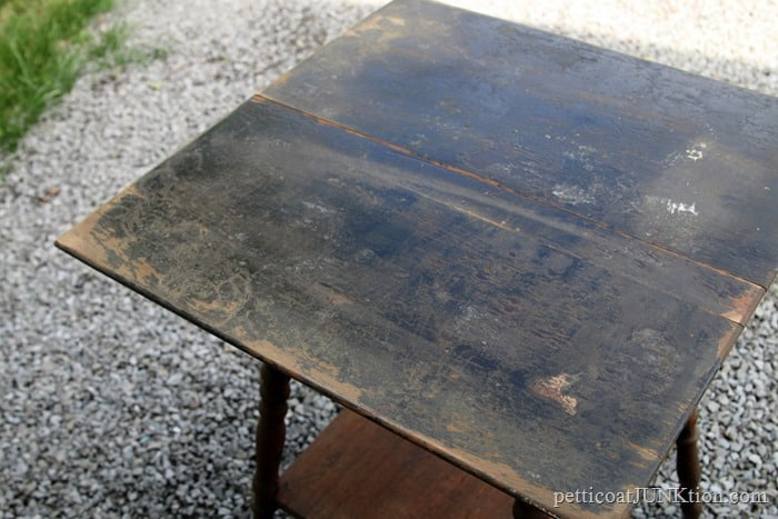 antique table with damaged stained finish