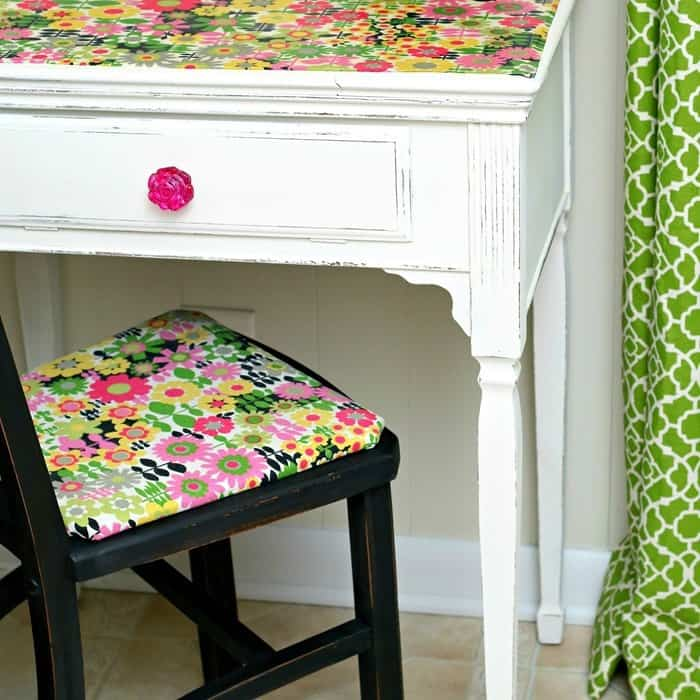Cover a chair seat with pretty floral fabric and use Mod Podge to adhere fabric to a desk