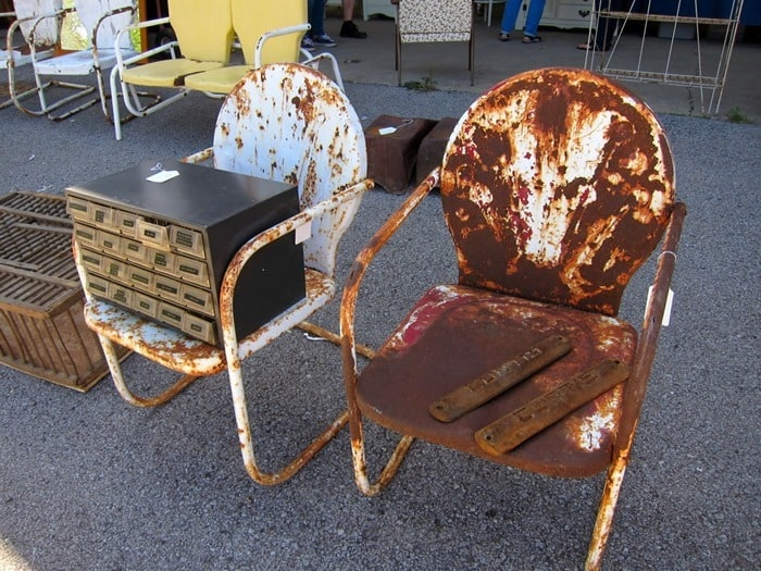 I'm in love with these rusty metal chairs found at the Nashville Flea Market photo by Petticoat Junktion