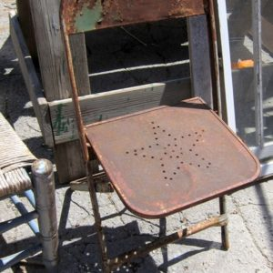 Rusty Metal Chair With Punched Star Design