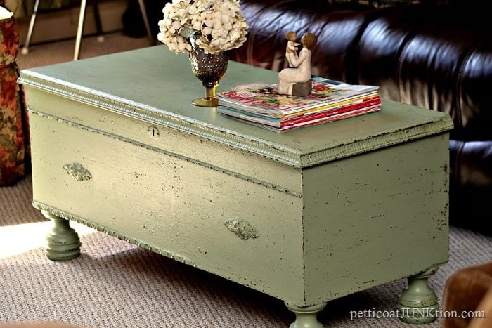 green chest with brown paint flecks