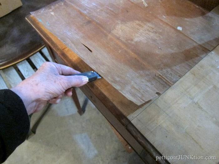 removing loose veneer