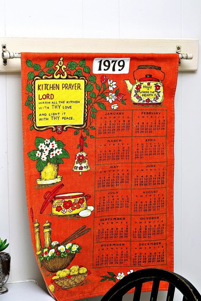 Hang A Vintage Tea Towel Calendar From A Curtain Rod