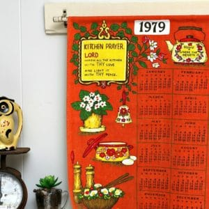 Hang A Vintage Tea Towel Calendar From A Curtain Rod