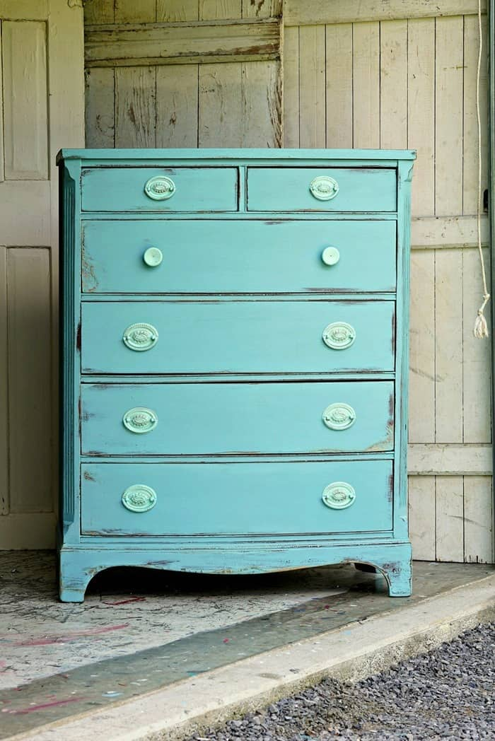 Damaged furniture painted turquoise and distressed to highlight the perfectly imperfect details