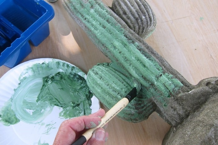 Painting a concrete cactus with watercolors