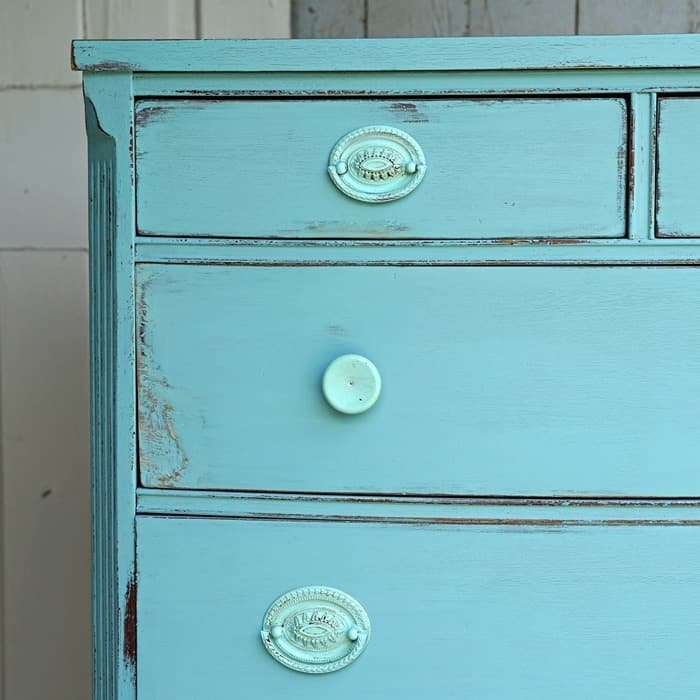 You can paint furniture with damaged veneer just distress it