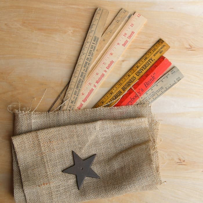 supplies to make a rustic flat using wood rulers and Duck Tape