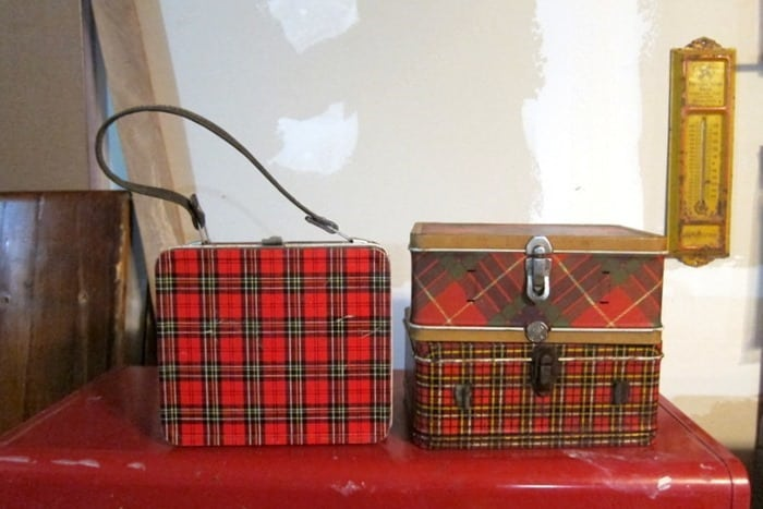 Plaid lunch boxes bought at auction