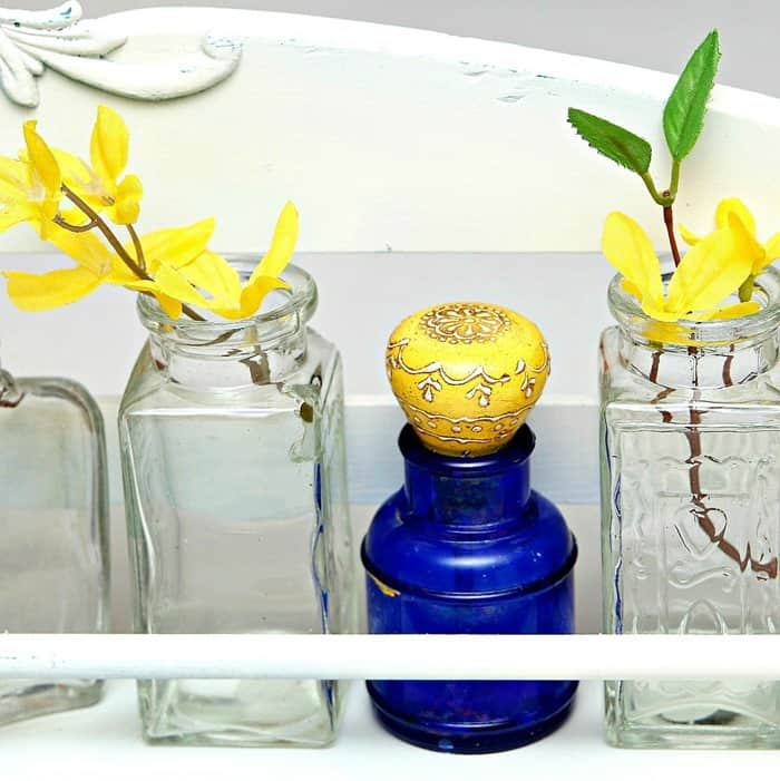 collectible blue glass bottles to display flowers