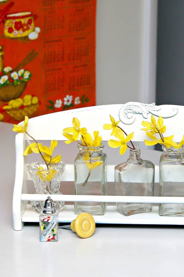 recycled spice rack makes a great flower display