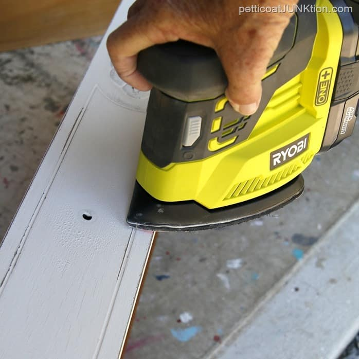 use a battery operated sander to distress paint