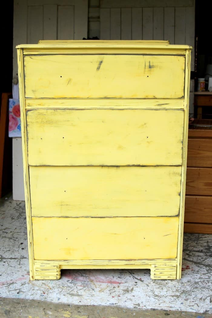 layered paint on furniture in gray and yellow
