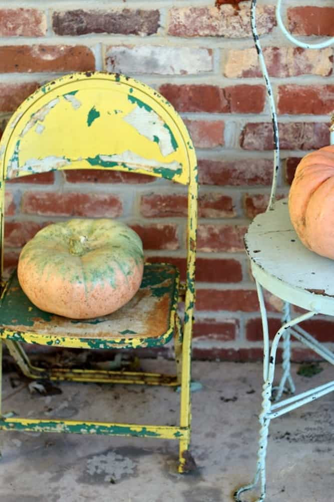 Fall pumpkin decor with yellow shabby chair