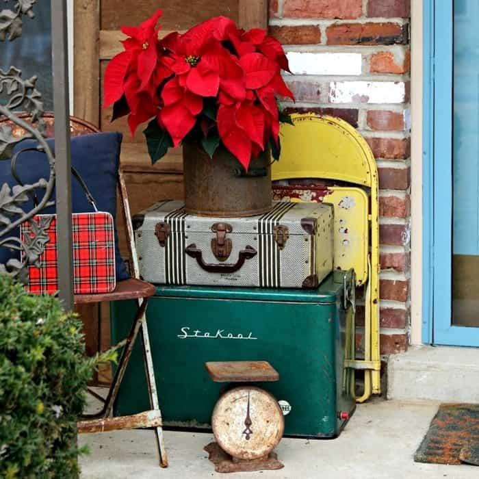 Christmas decorating with vintage luggage and metal chairs