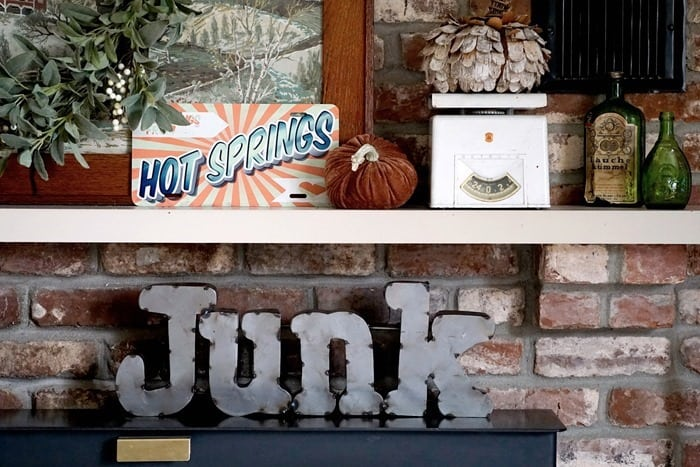 Decorating the fireplace mantel with junk finds